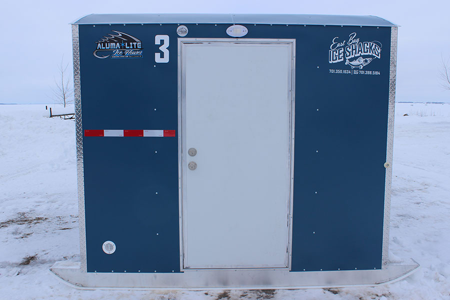 Eastbay Campground blue ice fishing house with door to enter.